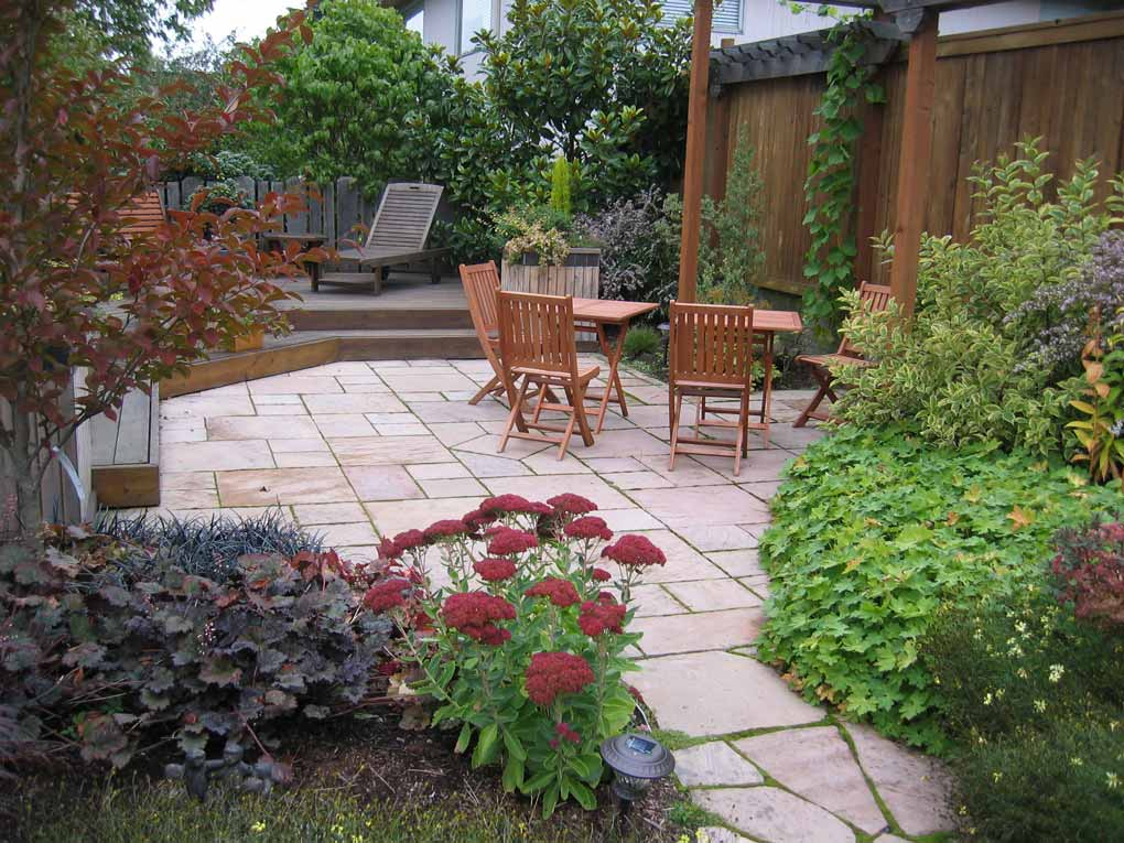 Stone paved patio and lush planings give year round interest