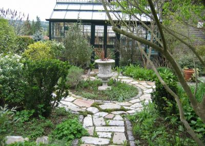 The English greenhouse presides over the circular path