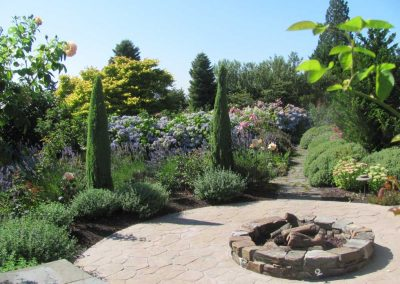 The firepit in this Bellevue garden gives a focal point to this circular patio