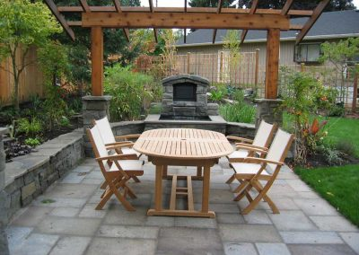 Outdoor dining under a wood arbor