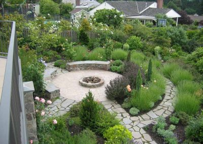 This Bellevue garden features a circular patio with roses, summer perennials and evergreen shrubs for winter interest