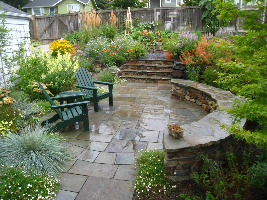 Stone benches and steps lend an arts and crafts style for outdoor living